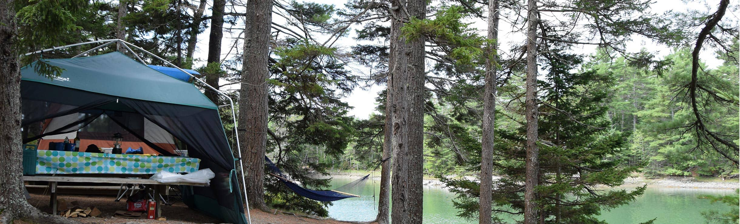 campsite with hammock overlooking the water